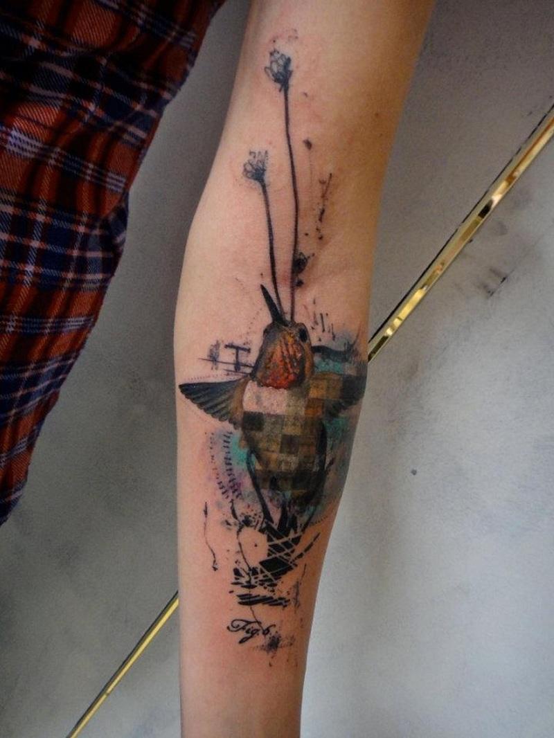 Watercolor hummingbird tattoo on arm