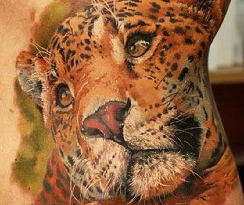 Watercolor leopard head tattoo on ribs by Dmitriy Samohin