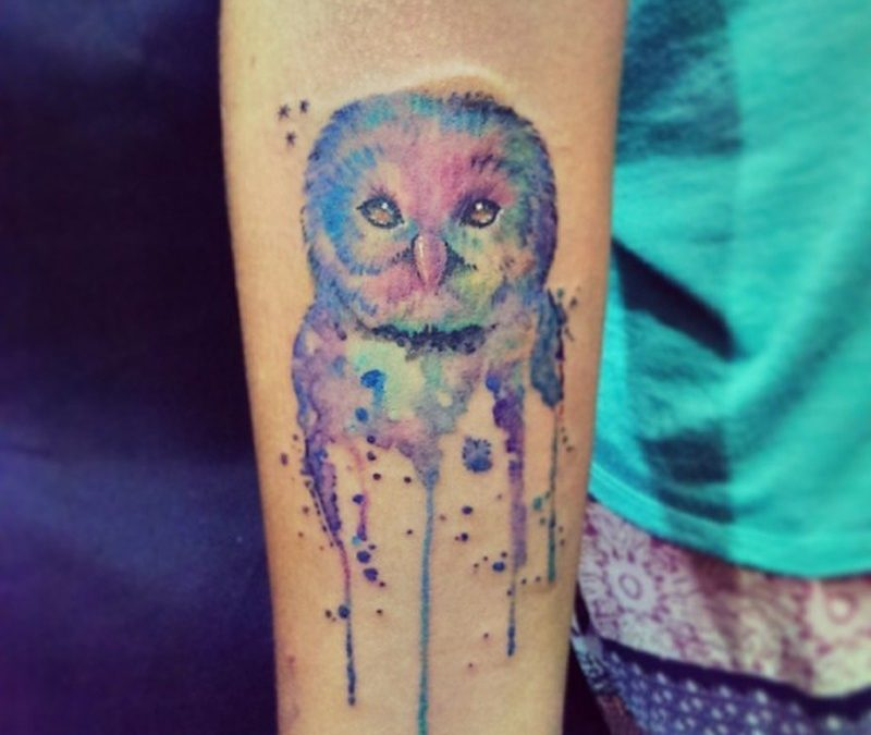 Watercolor owl tattoo on arm