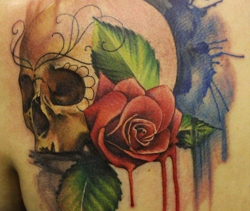 Watercolor skull and red rose tattoo on shoulder blabe
