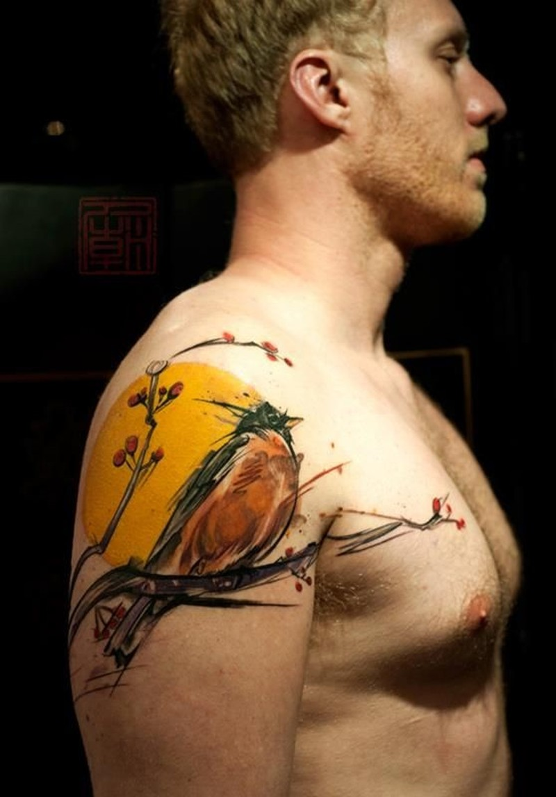 Watercolor tattoo bird on arm