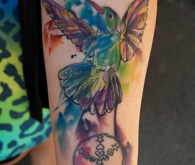Watercolor tattoo bird on leg