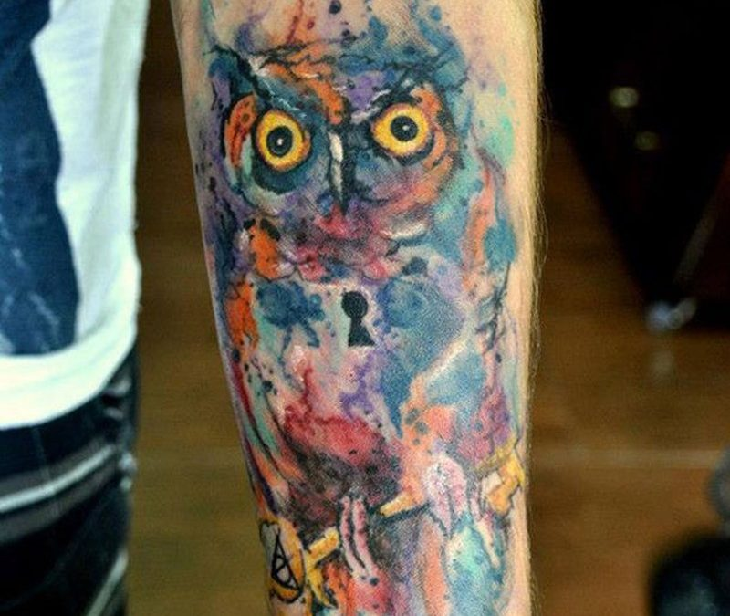 Watercolor tattoo owl on arm