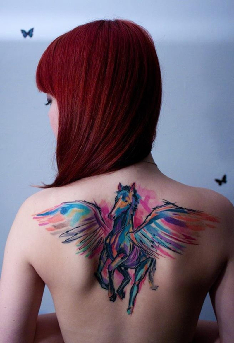 Watercolor winged horse tattoo on upper back