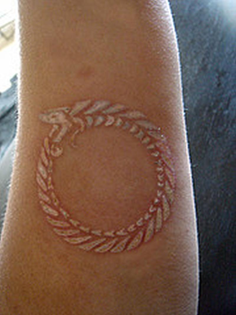 White ink snake circle tattoo design