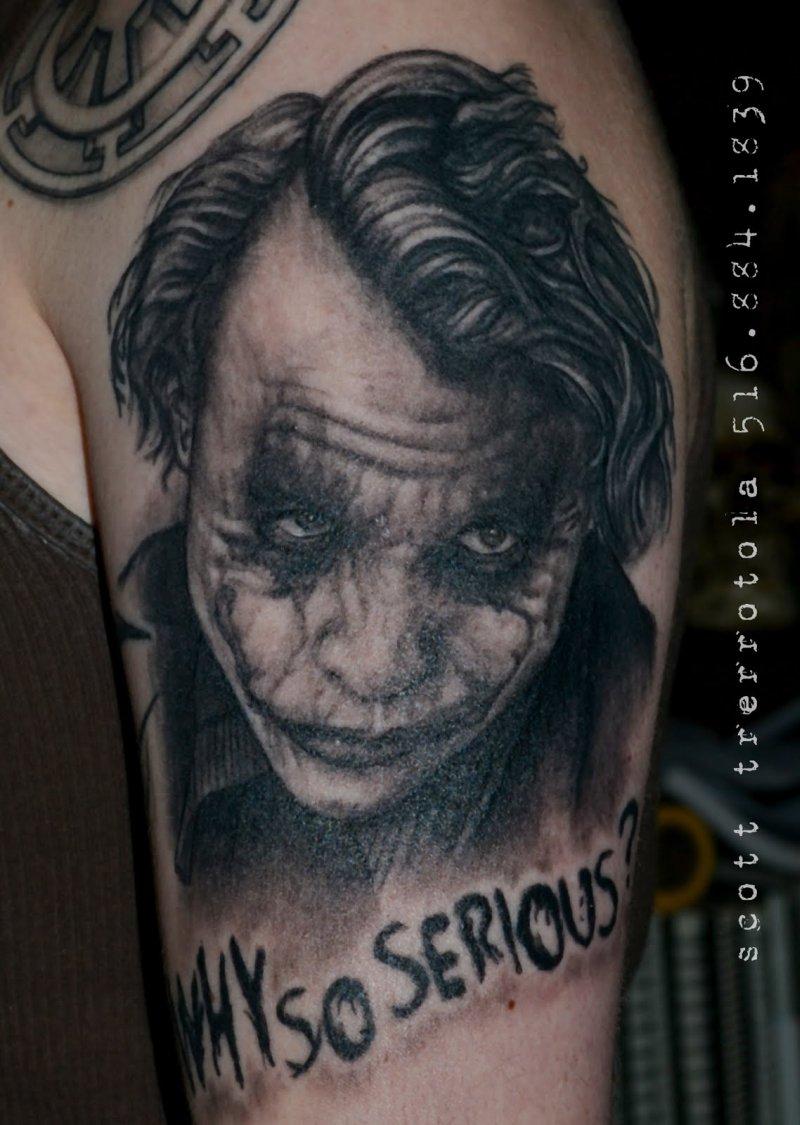 Why so serious batman joker tattoo on arm