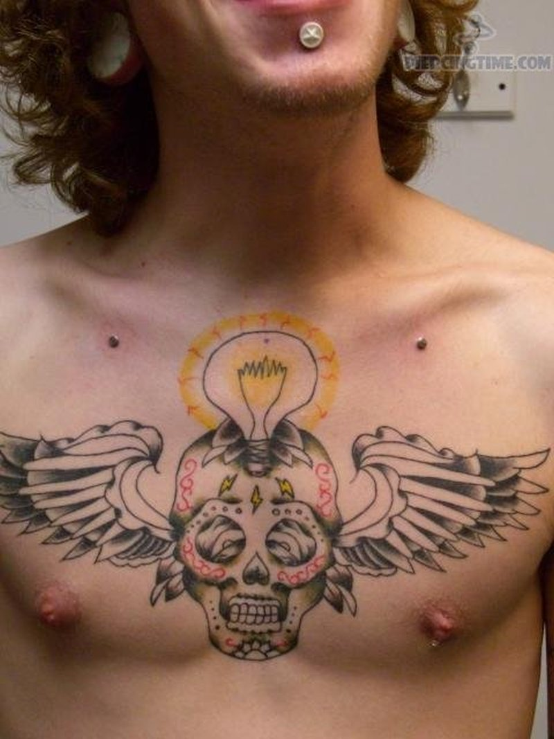 Winged bulb skull tattoo collarbone piercing