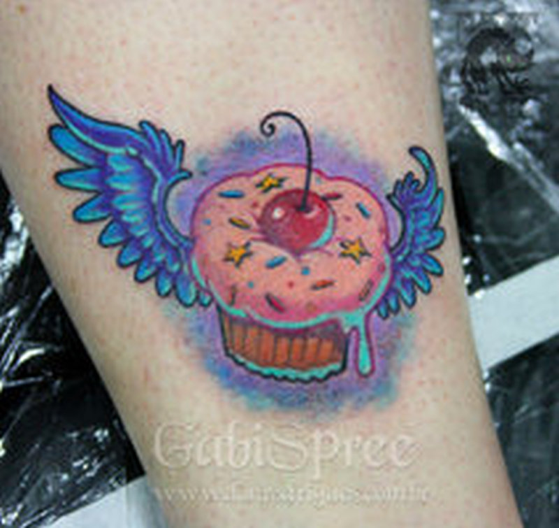 Winged cup cake tattoo design