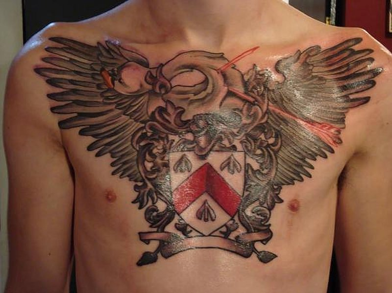 Winged family crest design on chest tattoo tattoos book for Chest tattoo prices