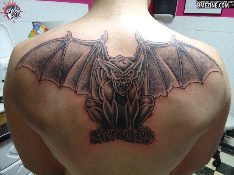 Winged gargoyle tattoo on upper back for men - Tattoos ...