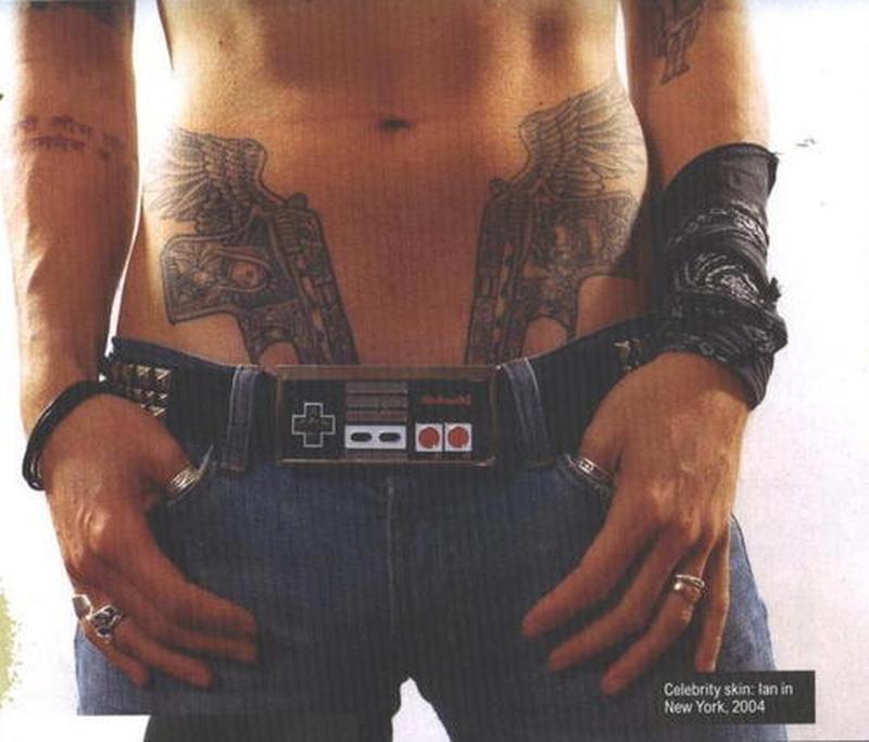 Winged gun tattoo design on stomach
