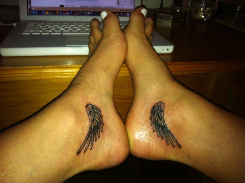 Wings tattoo on feet