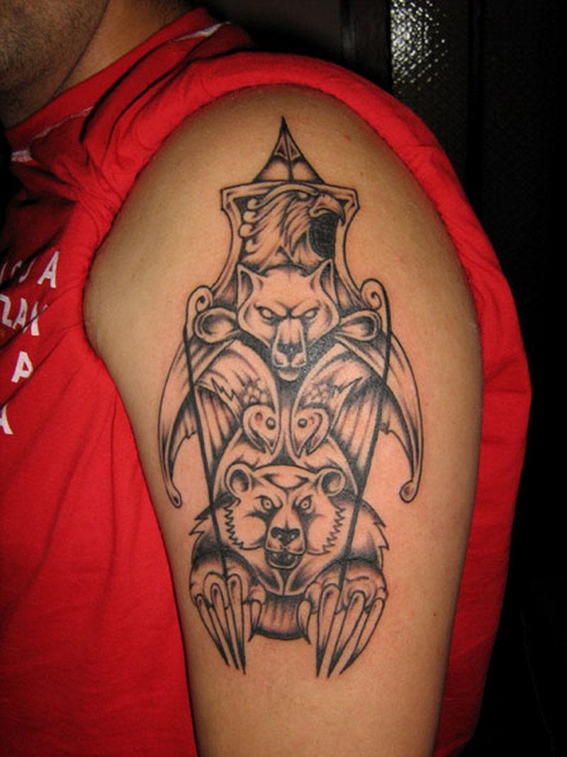 Wolf bear tattoo on biceps