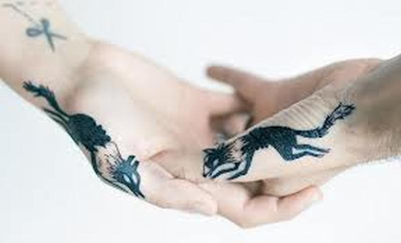 Wolf couple tattoo design