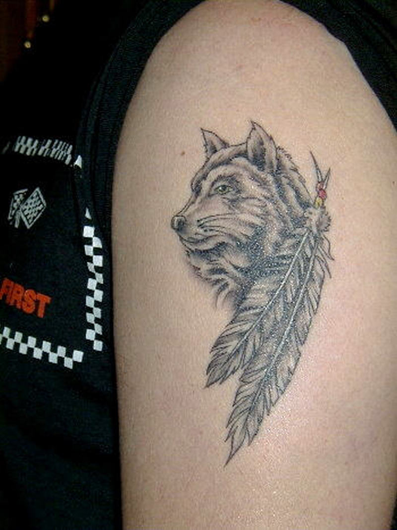 Wolf face feather tattoo on biceps