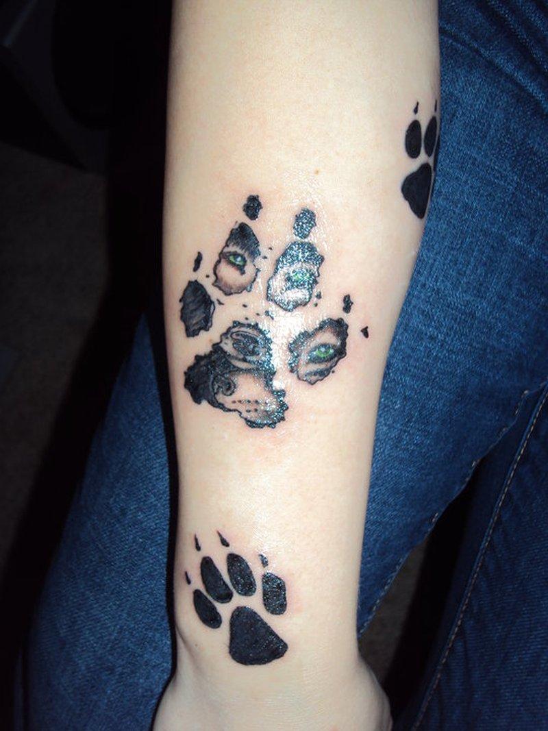 Wolf footprints tattoo design