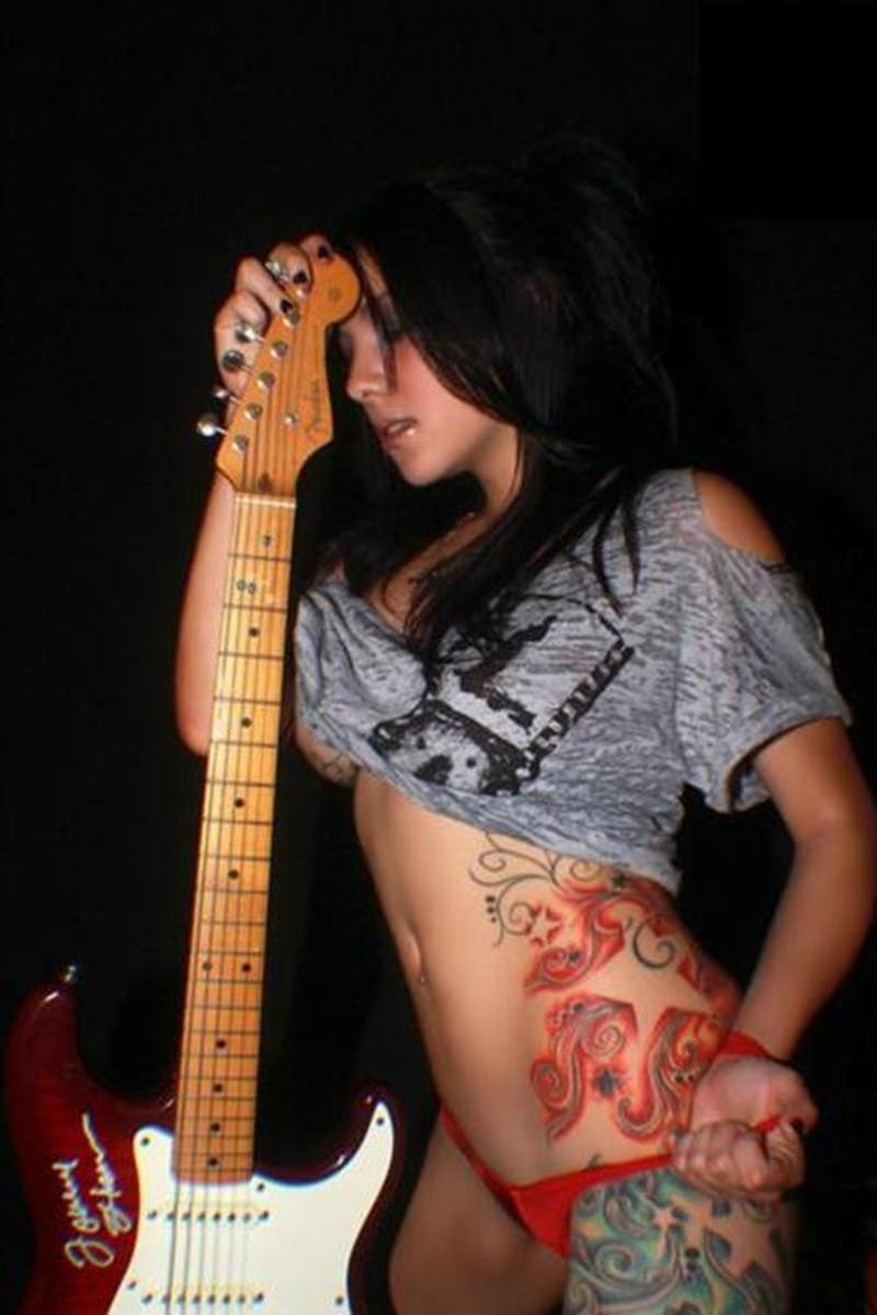 Woman with guitar n feminine tattoo designs