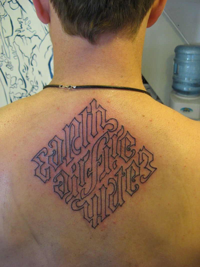 Wonderful ambigram on upper back tattoo