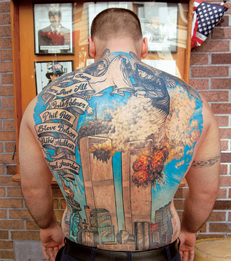 Wonderful firefighter tattoo on full back
