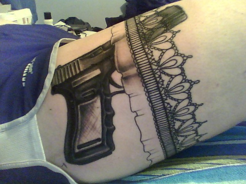 Wonderful garter gun tattoo design