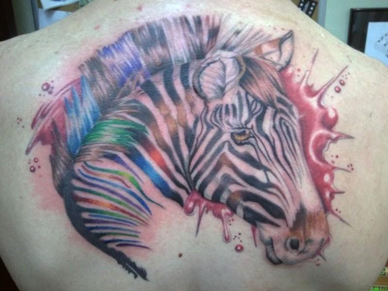 Wonderful watercolor portrait of zebra tattoo on back by flicka