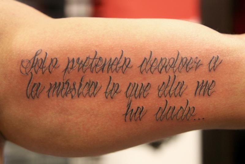 Wording tattoo on biceps