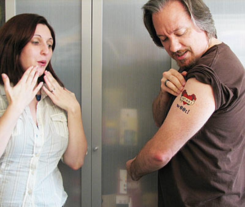 Wow geek tattoo on biceps