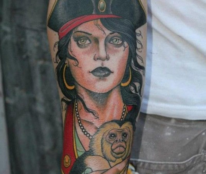 Young woman with a monkey pirate tattoo by hakan havermark
