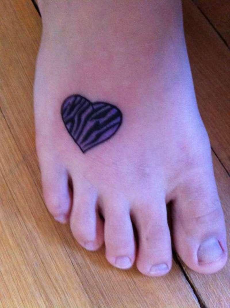 Zebra heart tattoo on right foot