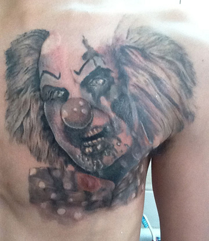 Zombie clown tattoo on chest 2