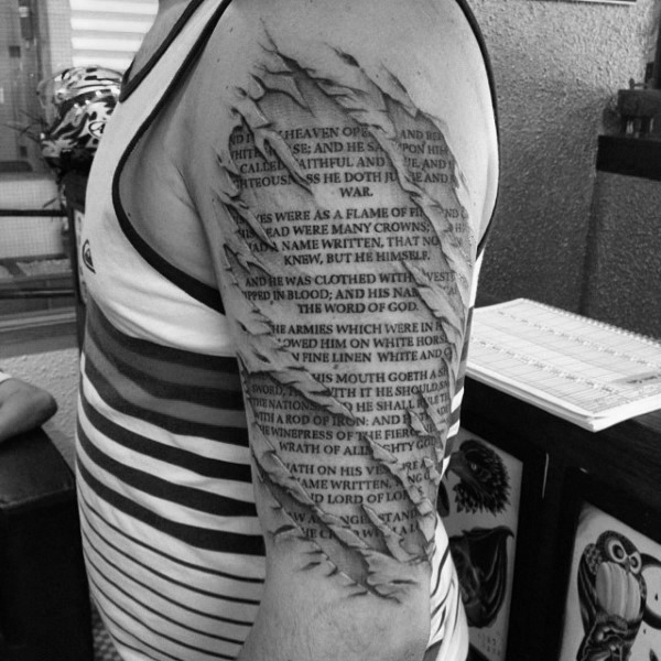 Outer Arm Tattoo of a Bible Verse Typed on Scroll Paper