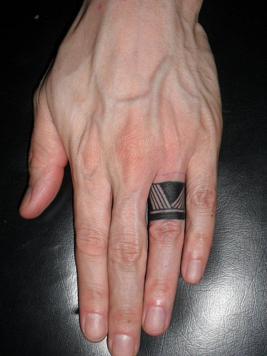 Aztec Symbol Ring Finger Tattoo