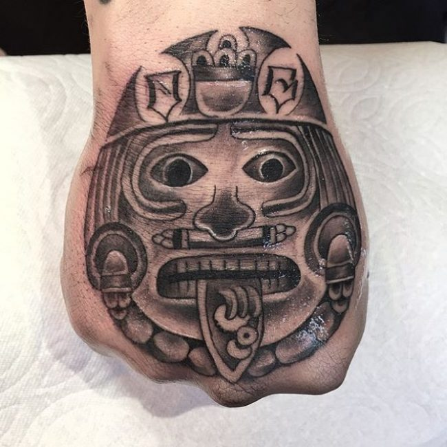 Aztec Death Mask Hand Tattoo