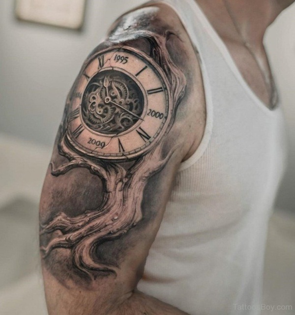 Shoulder Tattoo of a Clock Growing from a Tree