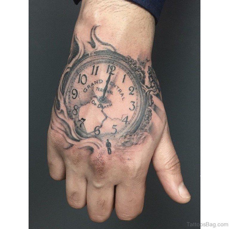 Clock on Fire Hand Tattoo