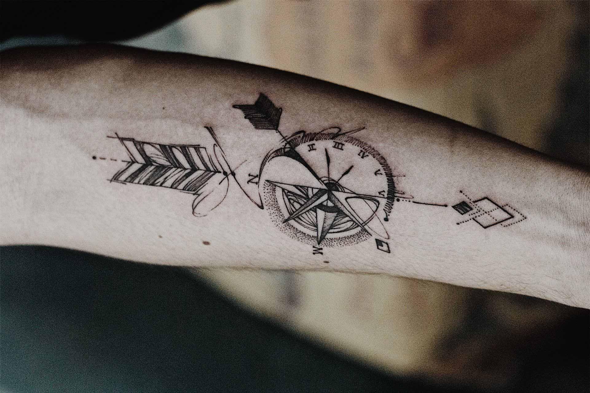 Minimalist Clock and Arrow Tattoo