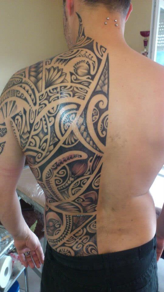 half back tribal design tattoo