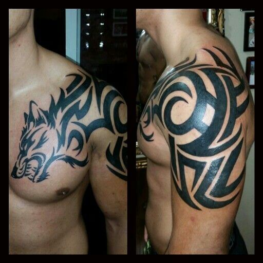 nice tribal wolf head tattoo on left chest and shoulder