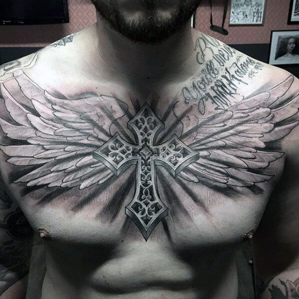 winged cross tattoo on chest