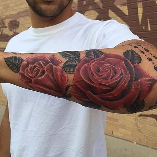 rose design tattoo on arm