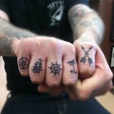 small finger tattoo for men