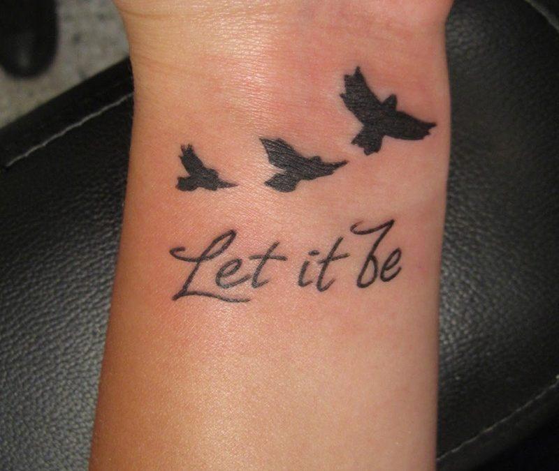 Bird Silhouette Tattoo On Neck