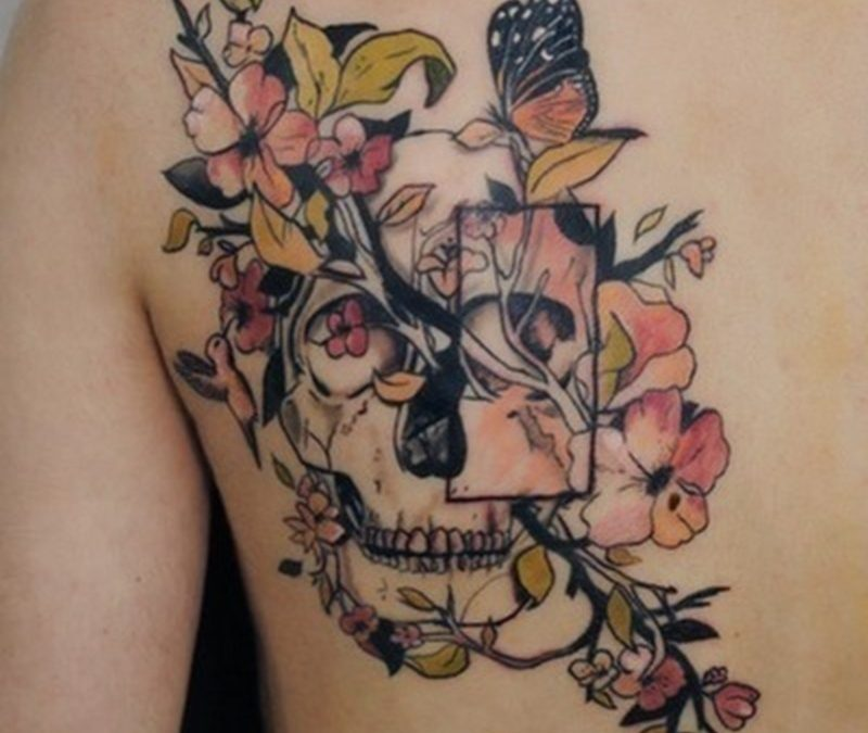 Abstract floral skull tattoo on back