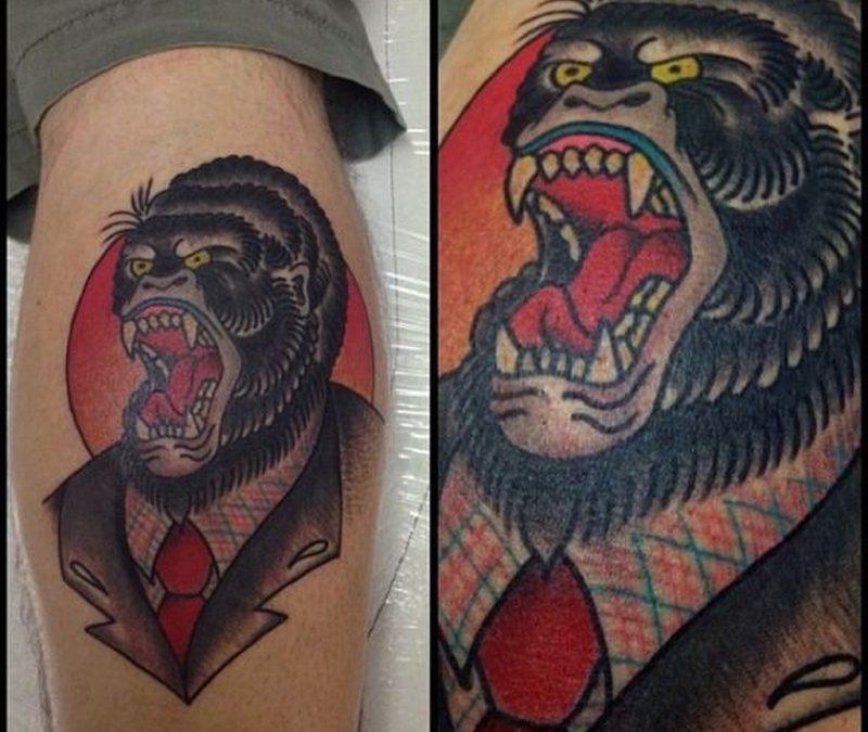 Aggressive gorilla wearing a jacket tattoo by Stephania Cuervo
