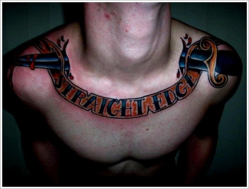Awesome coloured dagger tattoo on collarbone