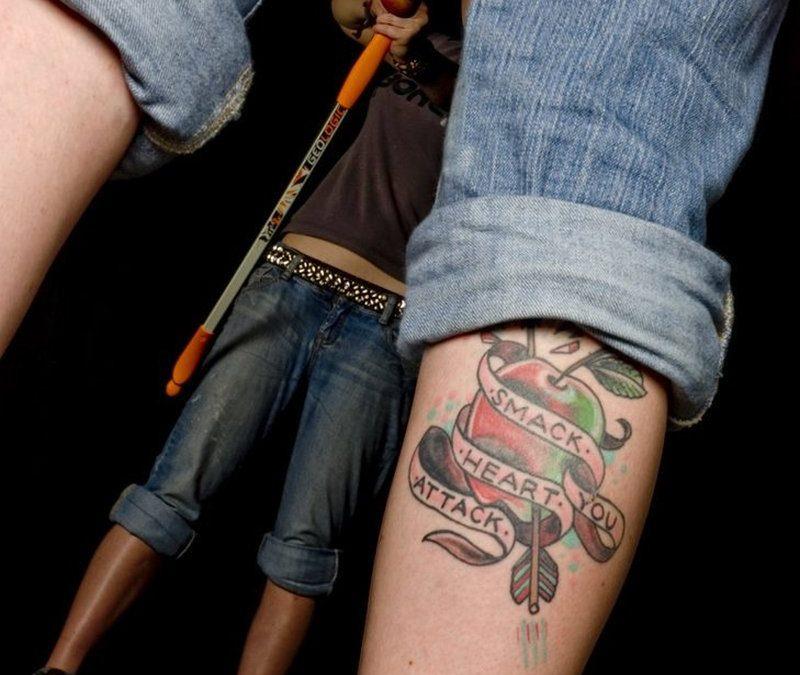 Banner apple tattoo on calf