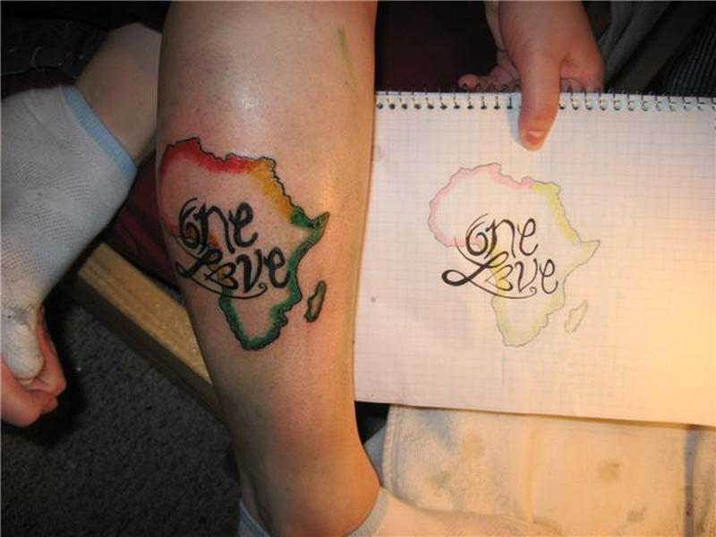 Beautiful one love african map tattoo on leg