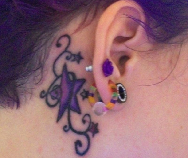 Beautiful star tattoo behind ear