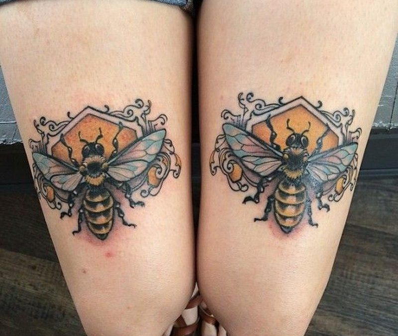 Bees on honeycomb tattoo on legs by Mike Moses
