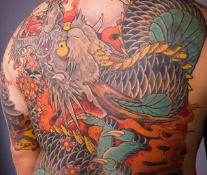 Big asian dragon tattoo on mans back